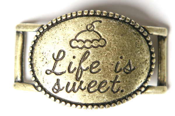 Life is Sweet. antique brass - Across The Way