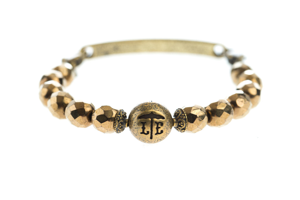 Logo Bangle Bronze - Across The Way