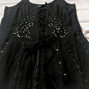 Close up image of a black dress's bead embroidery - 9Lilas