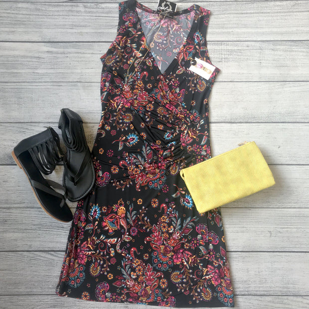 Image of black wrap dress with red floral pattern, black sandals, and a yellow purse - 9Lilas