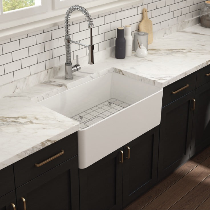 Bocchi contempo single bowl installed with dark cabinets and bridge faucet