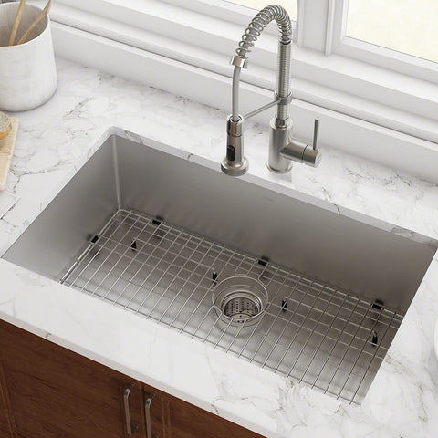 Gauge Undermount Single Bowl Stainless Steel Kitchen Sink with pull down faucet in a bright kitchen