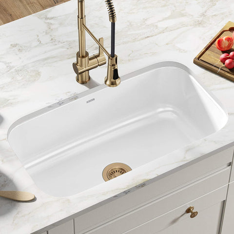 Single Bowl Enameled Stainless Steel Kitchen Sink in a bright kitchen with pull down faucet