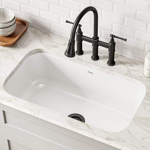 Single Bowl Enameled Stainless Steel Kitchen White Sink in a bright brick kitchen with pull down black faucet