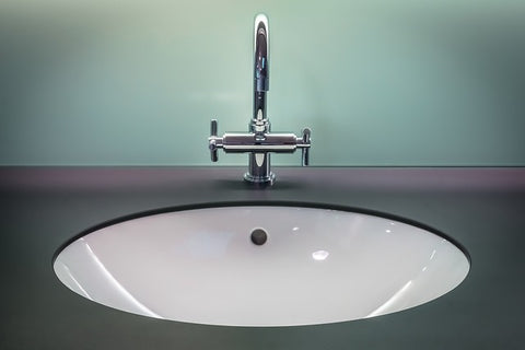 bathroom sink with stainless steel faucet