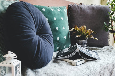 blue, green and gray cushions