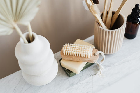 close-up of table with bathroom accessories and brushes