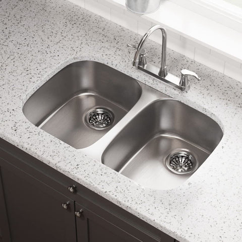 double bowl stainless steel kitchen sink in a bright kitchen