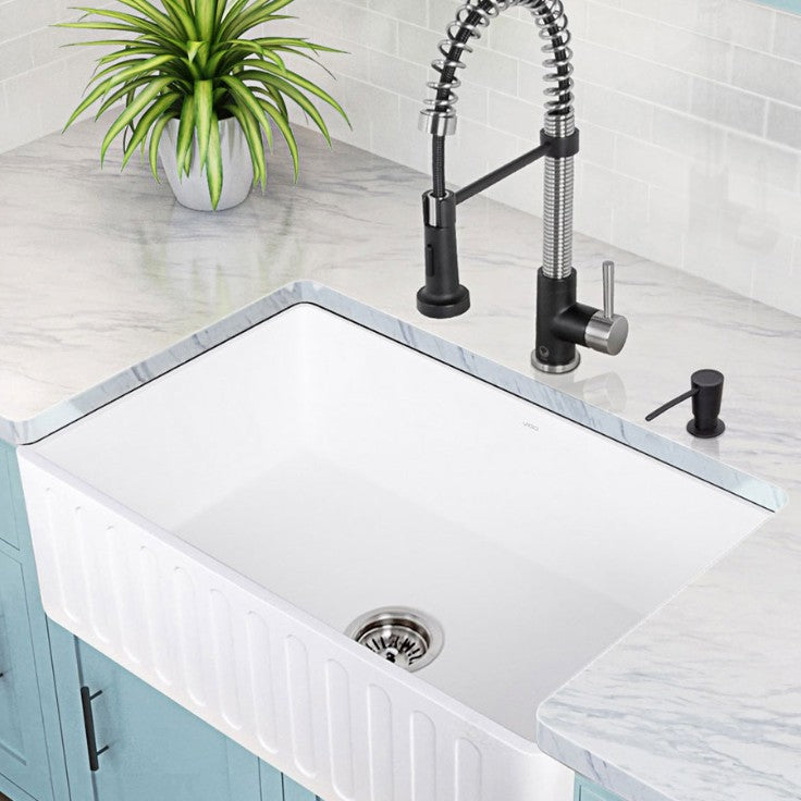 Fireclay farmhouse sink with blue cupboards