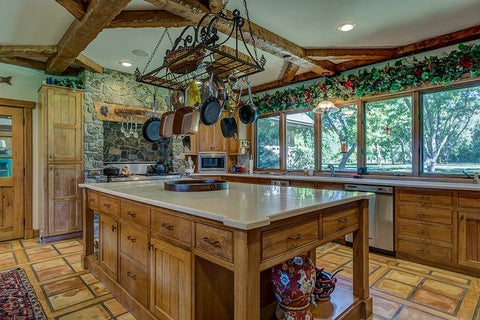 kitchen island with pans above it