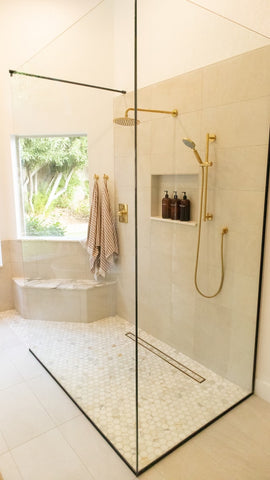 shower with gold accents