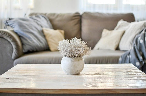 sofa in front of a coffee table with decor