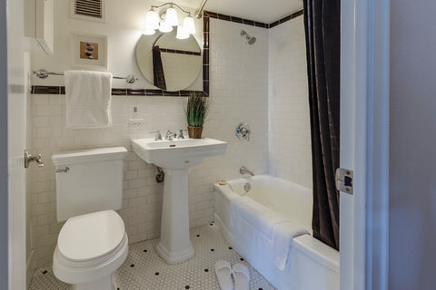 white bathroom with lights turned on
