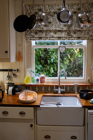 white famhouse sink beside unwashed dishes