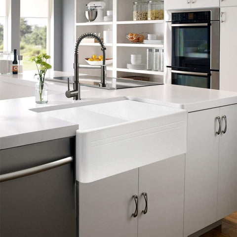white fireclay sink with other features in a bright kitchen