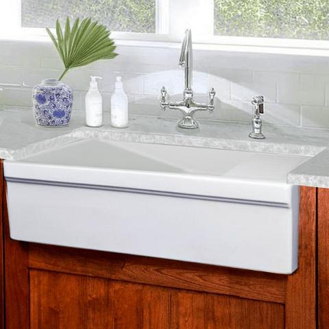 white sink with wooden cabinets