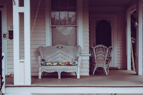 wicker chair by the porch