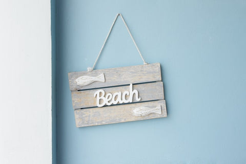 wooden sign that says beach