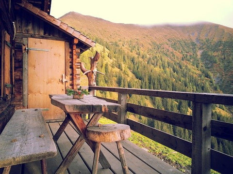 wooden table and bench overlooking hills and trees