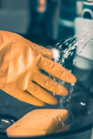 yellow cleaning gloves and sponge