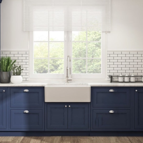 Bocchi white fireclay sink with blue cabinets