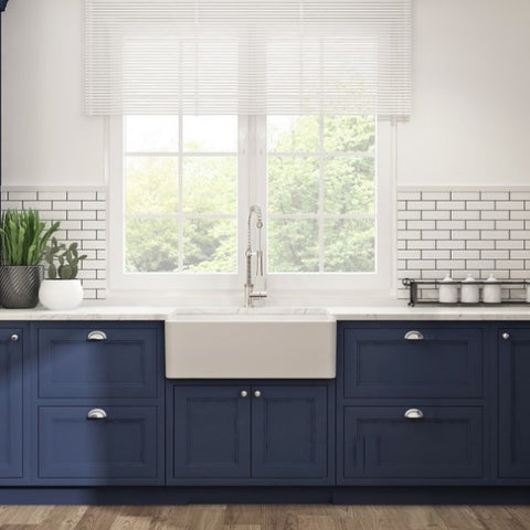 Image of Bocchi white fireclay sink with blue cabinets