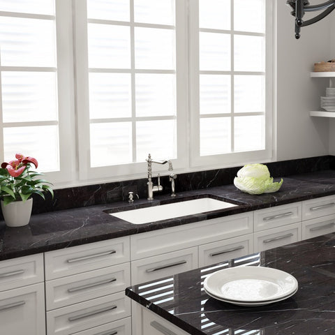 Image of Bocchi sotto 32 installed with black counter top