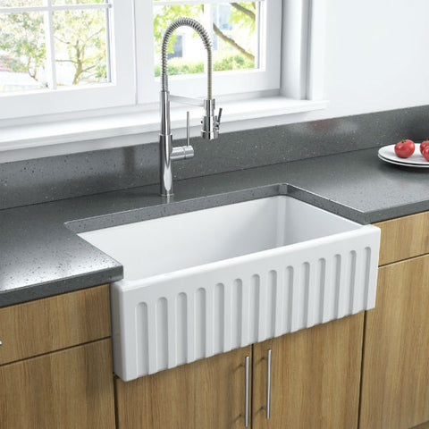 Image of Latoscana LFS3318W White Fireclay Farmhouse Sink fluted design with wood finish cabinets