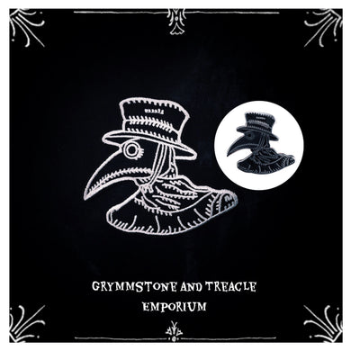 Embroidered steampunk Plague Doctor Patch in Black and White with enamel and metal gothic plague doctor pin to the right