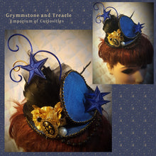 Blue and Gold round steampunk fascinator with blue stars