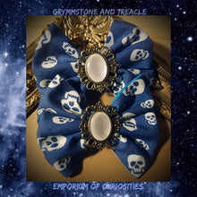 A Pair of Handmade Hair Bows made in blue with white skull drill fabric with pearl and brass filigree cameo Hair Bows