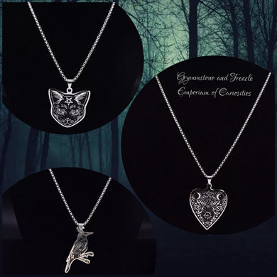 Gothic necklaces - Sacred Black Cat with Pentagram on top left, Petit Planchette with ornate filigree design on middle right, and Phantom Crow skeleton necklace on bottom left