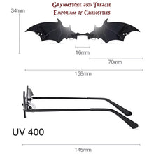Photo of Gothic Sunglasses with Bat shape showing measurments