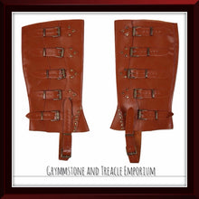 Faux leather spats that sit over top of your shoes. caramel brown with bronze rivets and buckles
