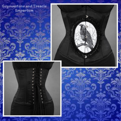 Gothic black corset with central raven cameo in black and white