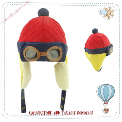 An aviator style beanie for babies or toddlers, in red and yellow with foam goggles and ear flaps