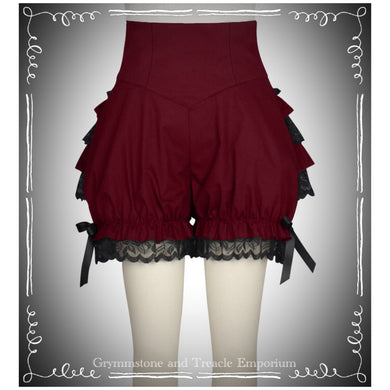 Red bloomers, above the knee with black lace ruffles over the bum and black ribbon ties on the sides. side zip with corsetted high waistband