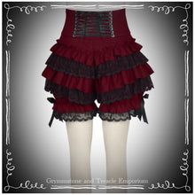 back of red bloomers with black ruffles and corsetted waist