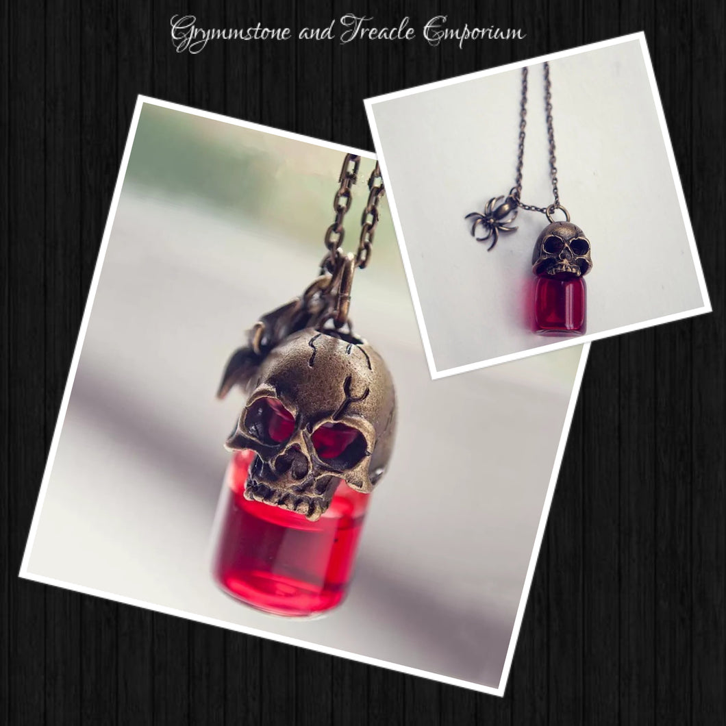 Tiny poison bottle filled with red liquid and topped with a brass skull and spider charm - pendant