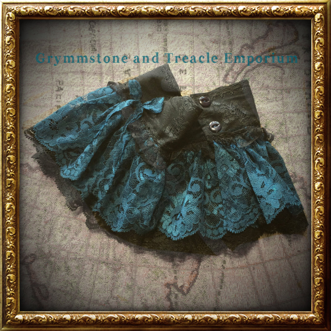Handmade Steampunk cuffs in a teal/cyan blue and black lace