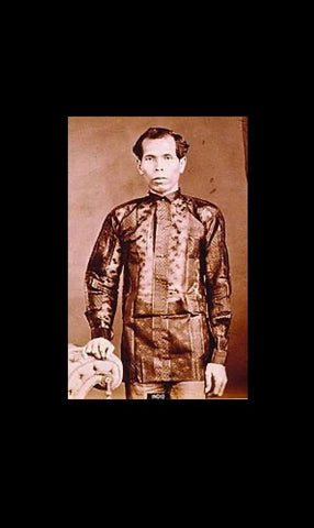 Native Filipino Man wearing color dyed striped and embroidered Barong Tagalog in late 1800's Philippines