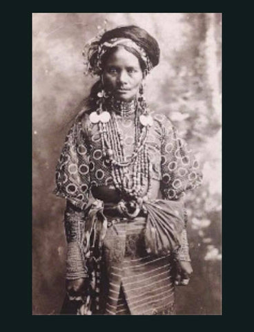 Woman form the Ignet tribe of Northern Luzon circa 1910. Illustrates the shape and form of the woman's baro and belt worn with loincloth/skirt
