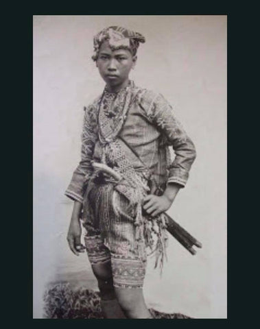 Young Bagobo male warrior of Southern Philippines circa 1920's. Illustrates the shape and form of the earliest baro