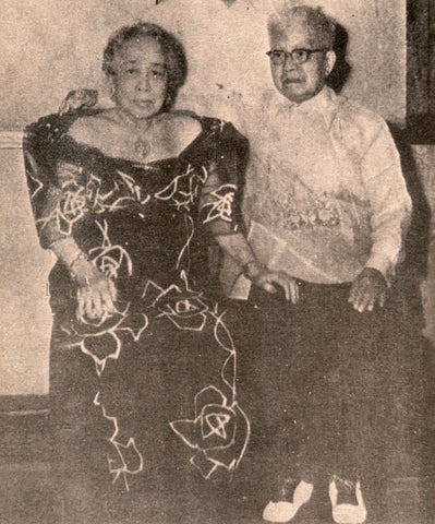 Emilio Aguinaldo with his second wife Maria Agoncillo, probably circa 1950's. He wears a formal barong with embroidery in natural off-white color