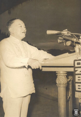 Laurel speaks to an audience in a barong. Photo is probably circa mid 1950's.