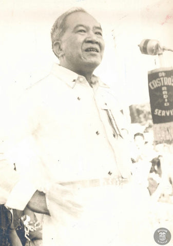 Laurel addresses a crowd in a Barong Tagalog embroidered with Philippine flags. Photo is likely circa mid to late 1950's