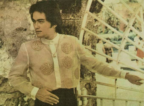 Castelo models a long sleeve, hand painted Danilo Franco barong that has a shortened fold down collar, shortened cuffs and a half button down design