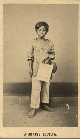 Studio portrait of a young lottery ticket boy in a work barong by Albert Honiss, Escolta, Manila 1868