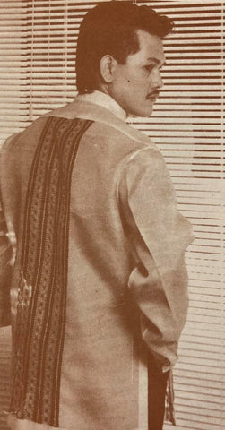 Alex Tinsay wears a Renee Salud barong with many vertical stripes and patterns embroidered on the back