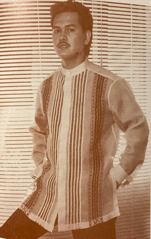 Alex Tinsay wears a Renee Salud barong with many vertical stripes and patterns embroidered on the front